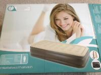 Inflatable twin size mattress with embedded electric pump