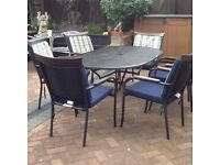 Oval garden table and sic chairs black wrought iron good quality