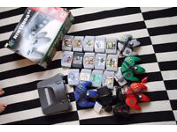 Nintendo N64 with 4 controllers, 1 rumble pack and 14 games