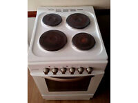Hardly used white cooker for sale. 4 hobs, grill and oven. Can Deliver and connect.
