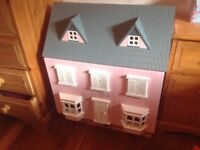 Dolls House with people and furniture.
