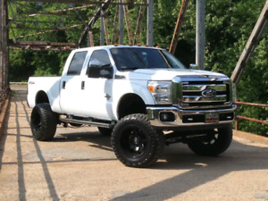 2011 Ford F250 Super Duty fx4 (lifted)