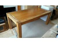 Solid wooden dining table. Signs of wear. Extends from 6 ft to 8½ ft.