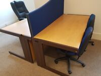 Four matching office desks complete with division screens