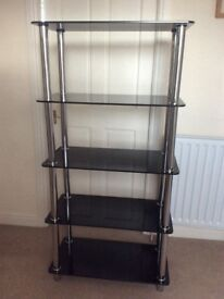 Four shelf black glass unit