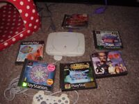 PLAYSTATION SLIM WITH GAMES