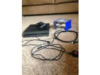Sony Playstation 4 with controller and 7 games