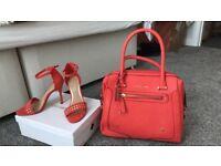 Head Over Heels stilettos and matching handbag