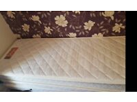 single bed with bed underneathe to make into double bed