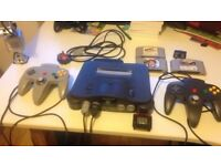 Black Nintendo 64 PAL edition, 2 Controllers, 3 games and jumper pak