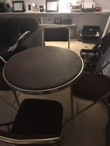 Card table and 4 chairs, great condition. 50 obo