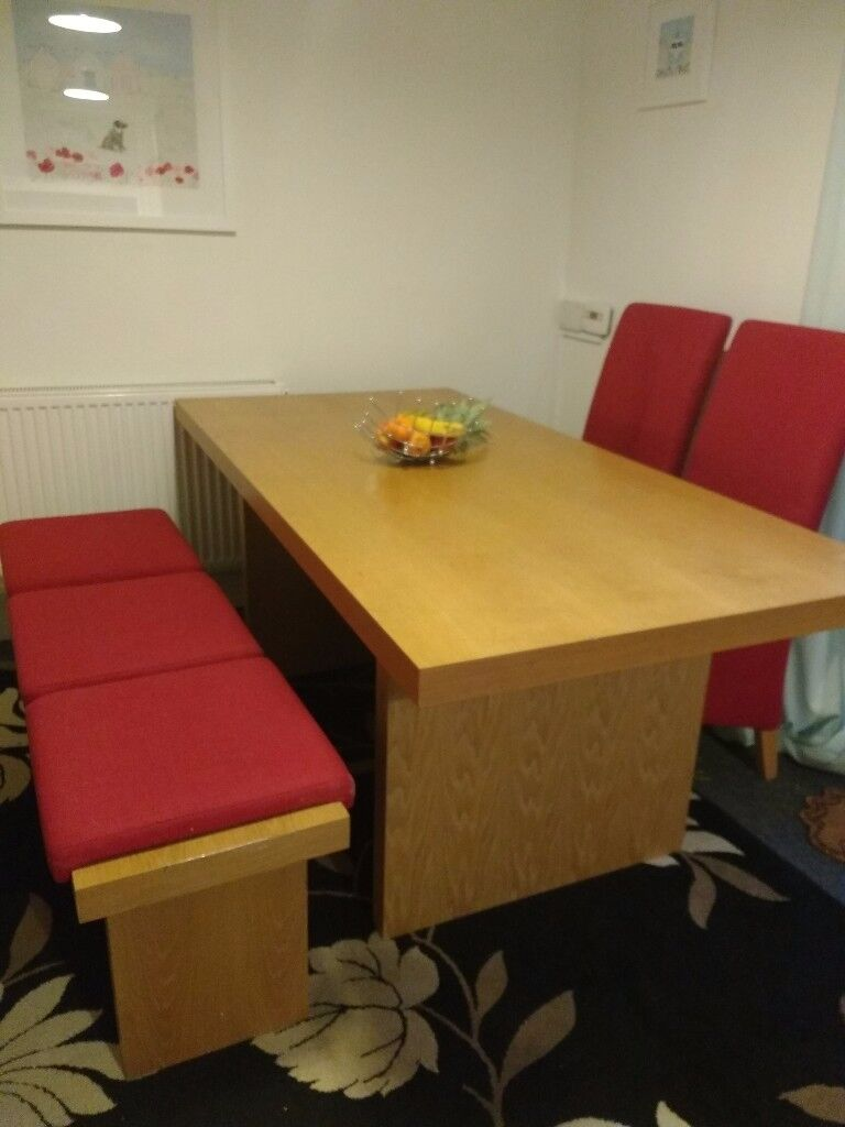 Universal table, with seats for 7in Redruth, CornwallGumtree - Very good clean condition. As seen in the picture comes with a bench, also four high backed red chairs. Selling as we are downsizing. Smoke and pet free home