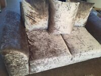 2x two seater crushed velvet couch with matching puffy