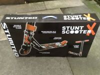 Stunt scooter new in sealed box black and orange age five to teenager