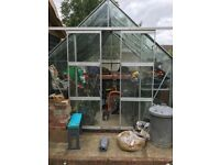 Large greenhouse with double sliding doors