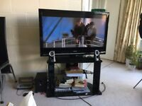 Trans-continental moving sale - Bed, dining room table +6 chairs, rugs, television, men's bike, more