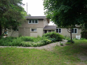 WATERFRONT HOME WITH 4+ ACRES IN THE CITY