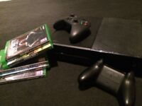 Black Xbox one,5games, 2 controllers with battery packs all wires included.