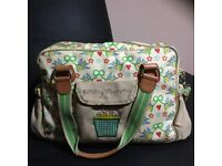 Green lining yummy mummy changing bag with changing mat .