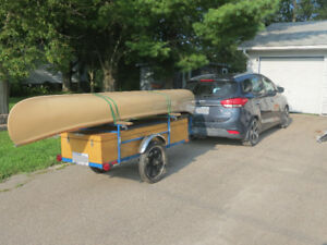 Canoe, with stabilizers, and a custom made trailer