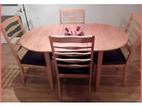 Dining table with 4 leather seat chairs