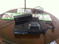 Xbox one with 8 games a kinnect and a headset