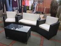 Wicker sofa and chairs set with glass table