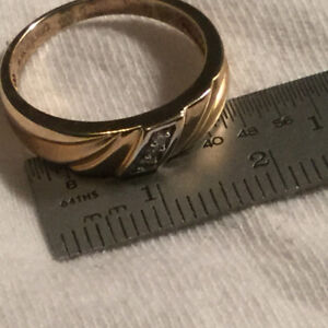 Brand new, never worn, gold ring with diamonds