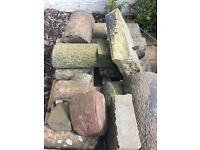 Large pile of sandstone blocks & curved coping stones