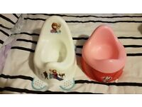 Pair of potties - Disney Frozen and a red and pink one (which also splits into two)