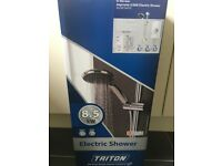 Brand new Triton Electric shower, gloss white 8.5kw
