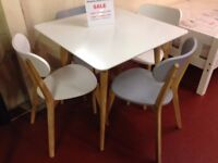 New small white dining table with the option of 2 or 4 stackable grey or white chairs £79