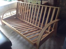 Wooden futon base without mattress. In good condition.