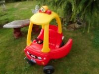 red and yellow cosy coupe car