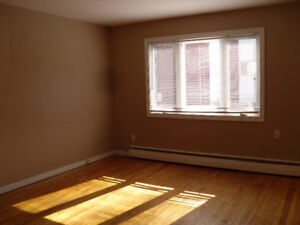 890$ Three bedroom heat, wifi, parking included for August 1st