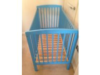 Toys r us blue cot with a pocket sprung mattress.