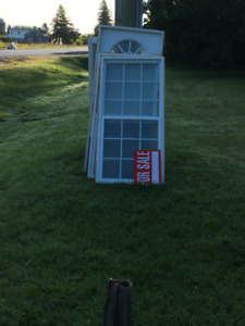 used windows and doors- single hungs 32x70x5 and fixed and doors