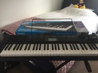 Electronic Keyboard CTK-1200, with box and stand.
