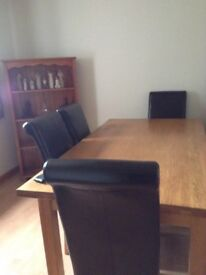 Table with 6 chairs excellent condition