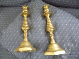 A pair of vintage brass candlesticks. Stamped Pd558118. From grandmothers loft. Need cleaning.