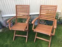 Pair of folding Teak Garden chairs with arms