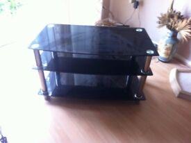 tv smoked glass tv stand (free)