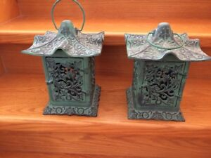 2 metal outdoor candle holders