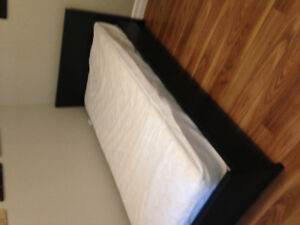 Twin bed with almost new mattress.