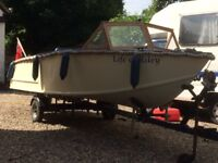 Boat with trailer and Honda 9.9 outboard