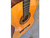 Herald HL44 Classical Guitar (includes; Case, picks, tuner and strap)