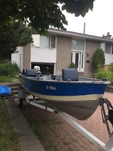 deep fishing boat 16 ft with 20 hp two storks Evinrude