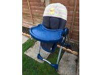 High chair on lock out wheels