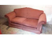 2 seater teracotta coloured sofa
