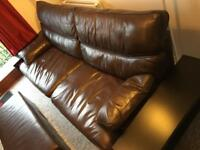 Leather sofa and foot rest